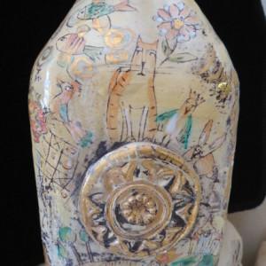 Bottiglia in ceramica con rosone